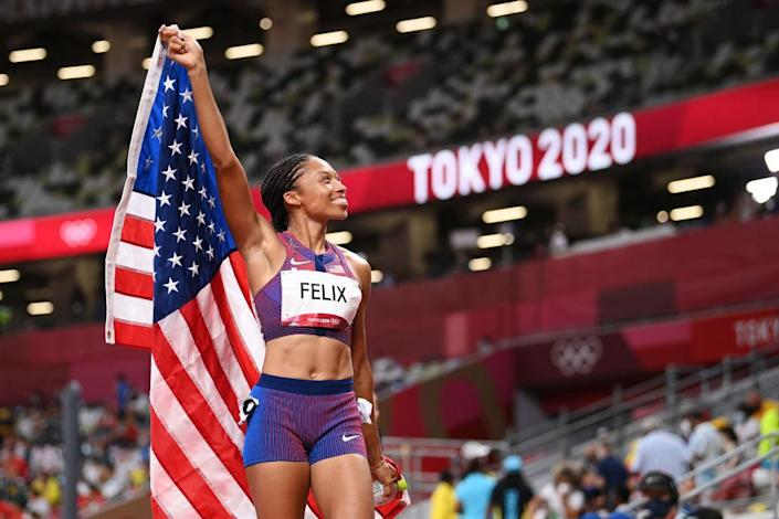 """Allyson Felix of Team USA reacts after winning the bronze medal in the Women's 400-m final on day fourteen of the Tokyo 2020 Olympic Games at Olympic Stadium on Aug. 06, 2021 in Tokyo, Japan.<span class=""""copyright"""">Matthias Hangst—Getty Images</span>"""