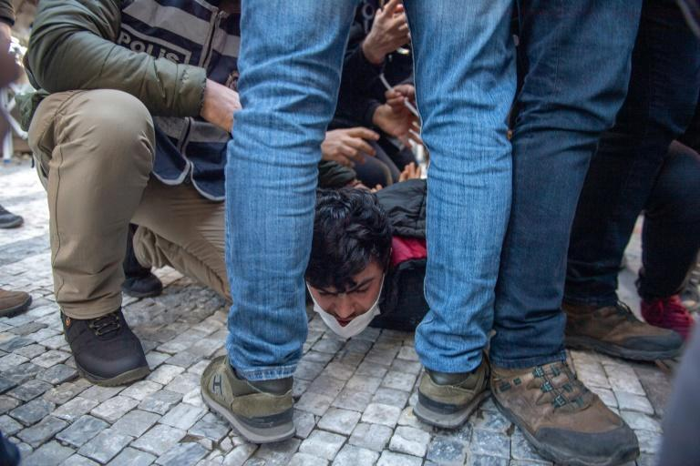 Police used riot shields and batons to break up an unsanctioned event in Istanbul and lead away more than 20 people
