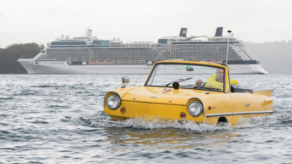 <p>Jason Fisher, head mechanic at Gosford Classic Car Museum drives a 1966 Amphicar 770 on the harbour with a cruise ship arriving behind it on Feb. 2, 2018 in Sydney, Australia. The museum, situated an hours drive north of Sydney on the Central Coast boasts a large collection of classic cars and this car and boat is the latest purchase for its collection. Photo from James D. Morgan/Getty Images. </p>
