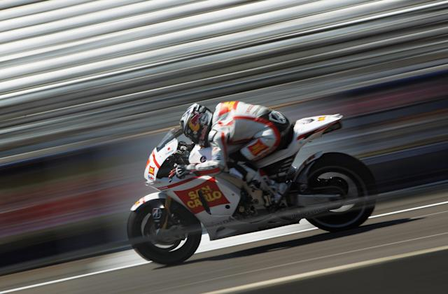 INDIANAPOLIS, IN - AUGUST 27: Marco Simoncelli #58 of Italy in action during Moto GP qualifying at Indianapolis Motorspeedway on August 27, 2011 in Indianapolis, Indiana. (Photo by Jamie Squire/Getty Images)