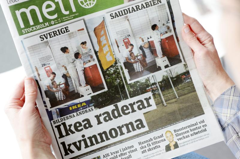 Person is holding the Monday Oct. 1 2012 issue of daily Metro fronted with two images from Swedish and Saudi Arabian IKEA catalogue for next year. Ikea is being criticized for deleting images of women from the Saudi version of its furniture catalogue, a move the company says it regrets. Comparing the Swedish and Saudi versions of the Ikea catalogue, Sweden's free newspaper Metro on Monday showed that women had been airbrushed out of otherwise identical pictures showcasing the company's home furnishings. The headline reads Ikea Erase Women. (AP Photo/Scanpix Sweden / Henrik Montgomery) SWEDEN OUT