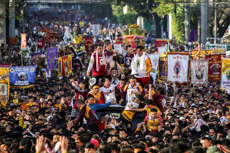 Filipino devotees join the annual Catholic procession of the Black Nazarene
