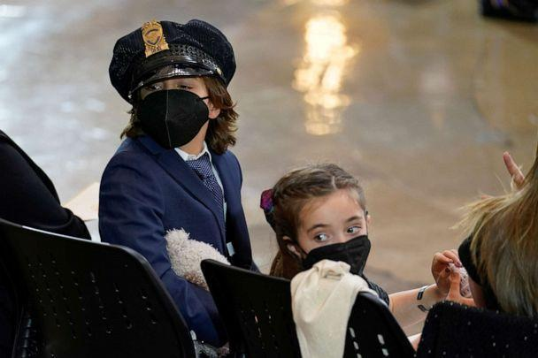 PHOTO: Logan, left, and Abigail, children of Capitol Police officer William 'Billy' Evans look around the rotunda as Evans lies in honor during a ceremony at the Capitol in Washington, DC, April 13, 2021. (J. Scott Applewhite/Reuters)