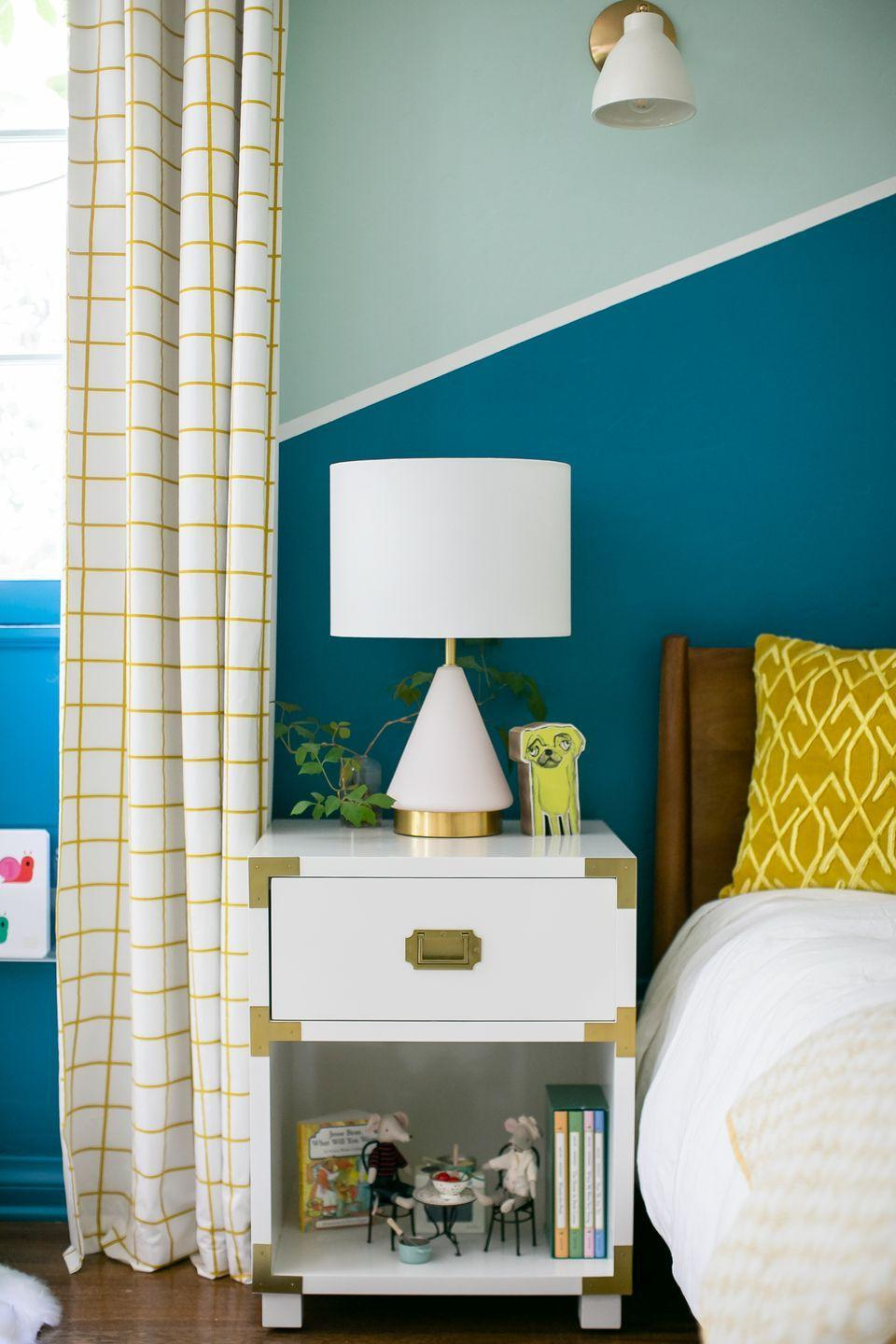 """<p>Teal is a no-fail choice for a bedroom, library, office or even cabinetry, according to designer and HGTV star <a href=""""https://breeganjane.com/"""" rel=""""nofollow noopener"""" target=""""_blank"""" data-ylk=""""slk:Breegan Jane"""" class=""""link rapid-noclick-resp"""">Breegan Jane</a>. Her favorite? Benjamin Moore's <a href=""""https://www.benjaminmoore.com/en-us/color-overview/find-your-color/color/2136-40/aegean-teal?color=2136-40"""" rel=""""nofollow noopener"""" target=""""_blank"""" data-ylk=""""slk:Aegean Teal"""" class=""""link rapid-noclick-resp"""">Aegean Teal</a>. """"Teal is reminiscent of the shimmering waters of Ibiza on a warm, sunny day,"""" says Jane. """"It's synonymous with serenity, and who couldn't use a little more of that?""""<br></p><p><a class=""""link rapid-noclick-resp"""" href=""""https://www.benjaminmoore.com/en-us/color-overview/find-your-color/color/2136-40/aegean-teal?color=2136-40"""" rel=""""nofollow noopener"""" target=""""_blank"""" data-ylk=""""slk:SHOP NOW"""">SHOP NOW</a></p>"""