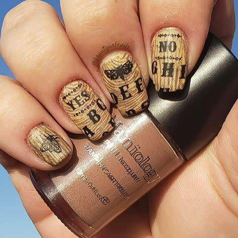 """<p>They may not help you summon any spirits, but these cute Ouija Board nails are perfect for Halloween anyway. </p><p><a href=""""https://www.instagram.com/p/CAoFecdgRjr/&hidecaption=true"""" rel=""""nofollow noopener"""" target=""""_blank"""" data-ylk=""""slk:See the original post on Instagram"""" class=""""link rapid-noclick-resp"""">See the original post on Instagram</a></p>"""