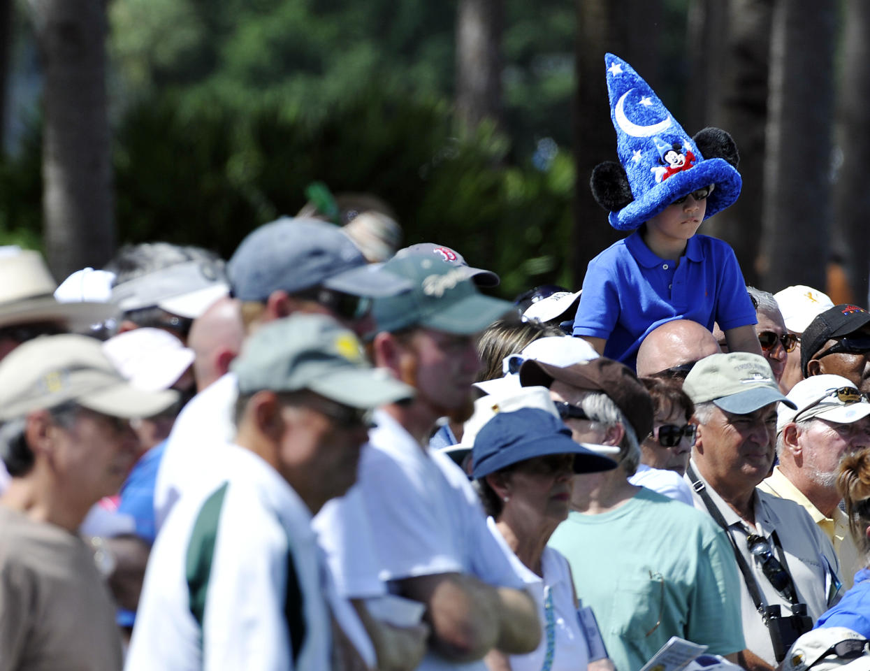 A young fan watches Rory McIlroy putt on the third hole during the second round of the Honda Classic golf tournament in Palm Beach Gardens, Fla., Friday, March 2, 2012. (AP Photo/Rainier Ehrhardt)