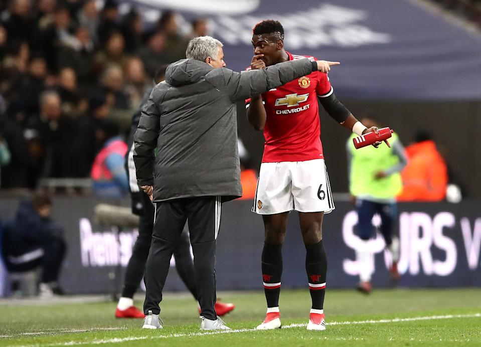 Pogba in discussion with Mourinho.