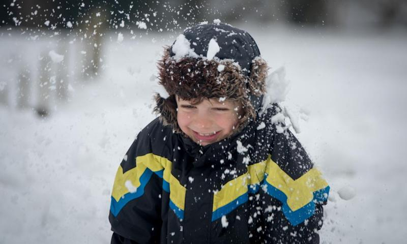 A boy laughs as he is hit by a snowball as he plays in the snow near Bath earlier this month. This weekend's cold weather is unlikely to bring as much snow.