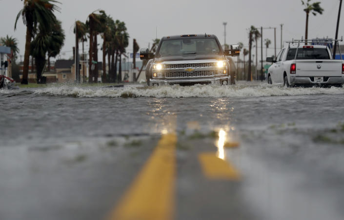 <p>A drives moves through flood waters left behind by Hurricane Harvey, Saturday, Aug. 26, 2017, in Aransas Pass, Texas. (Photo: Eric Gay/AP) </p>