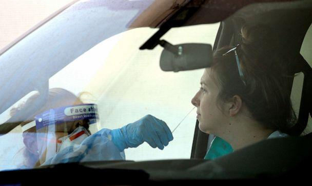 PHOTO: People get tested at a drive thru coronavirus testing site at South Mountain Community College, Thursday, July 9, 2020, in Phoenix. (Ross D. Franklin/AP)