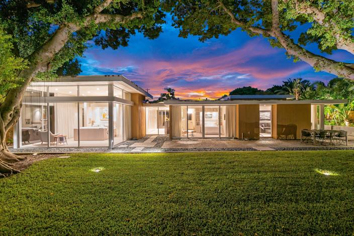 Modernist architect William Rupp, part of the Sarasota School, designed this home, which was later renovated by Seibert Architects, in the Lido Shores neighborhood. Floor-to-ceiling windows connect the rooms to the interior courtyard, which includes seating and dining areas as well as a lap pool. Owners will have access to the neighborhood's private beach park.