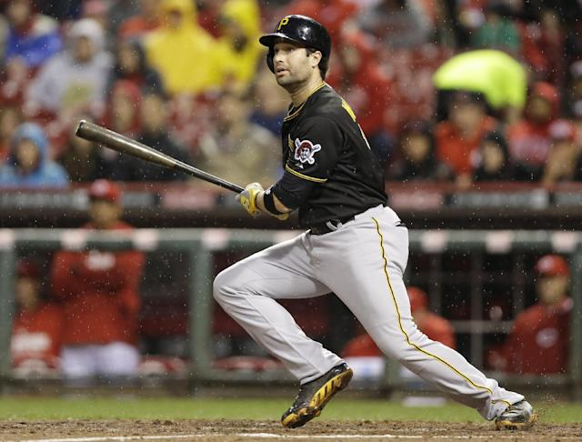 Pittsburgh Pirates' Neil Walker gets a hit off Cincinnati Reds starting pitcher Homer Bailey in the fourth inning of a baseball game, Monday, April 14, 2014, in Cincinnati. (AP Photo/Al Behrman)