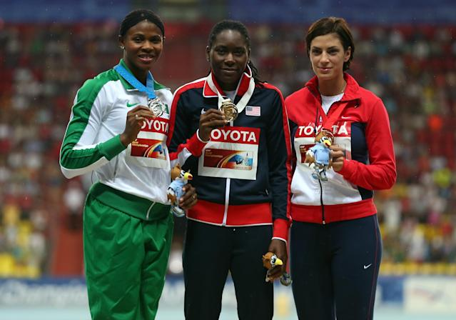 MOSCOW, RUSSIA - AUGUST 11: (L-R) Silver medalist Blessing Okagbare of Nigeria, gold medalist Brittney Reese of the United States and bronze medalist Ivana Spanovic of Serbia stand on the podium during the medal ceremony for competes in the Women's Long Jump final during Day Two of the 14th IAAF World Athletics Championships Moscow 2013 at Luzhniki Stadium on August 11, 2013 in Moscow, Russia. (Photo by Mark Kolbe/Getty Images)