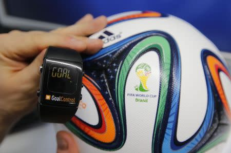 A GoalControl watch is displayed next to an official FIFA 2014 World Cup Brazil football during demonstration of goal-line technology in Aachen