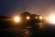 Military vehicles of the Russian peacekeeping forces are seen on a road near Goris