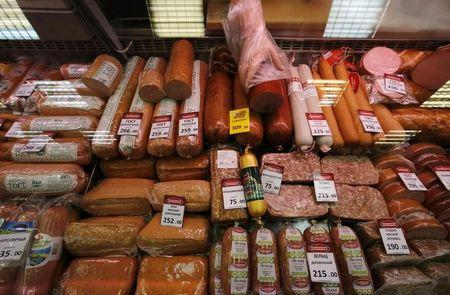 Meat and sausage goods are on sale at a grocery store in St. Petersburg