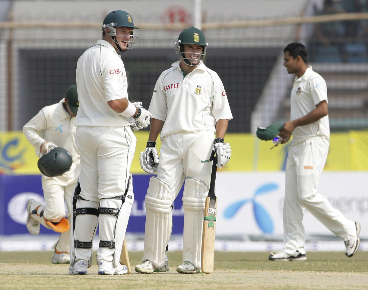 CHITTAGONG, BANGLADESH - MARCH 1:  Graeme Smith and Neil McKenzie of South Africa smile after setting a new first wicket partnership world record of 415 runs during day two of the second test match between Bangladesh and South Africa held at the Shrestha Shahid Ruhul Amin Stadium on March 1, 2008 in Chittagong, Bangladesh. (Photo by Duif du Toit/Gallo Images/Getty Images)