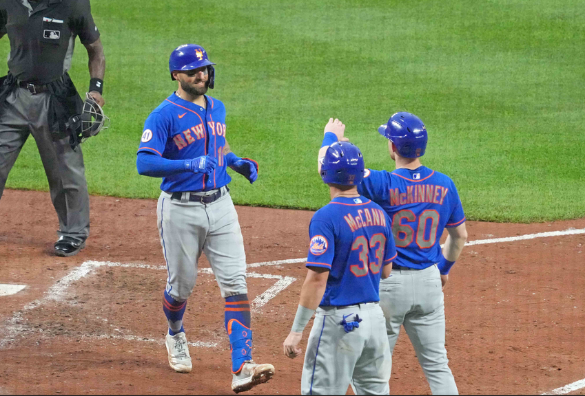 Pillar greeted by KcKinney and McCann after HR in Baltimore blue unis