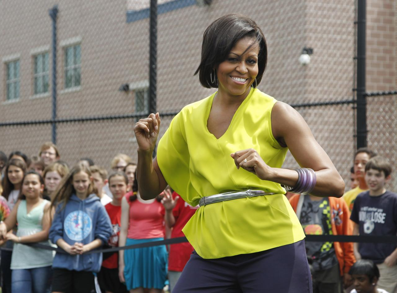 First lady Michelle Obama dances with students at Alice Deal Middle  School in northwest Washington, Tuesday, May 3, 2011, during a surprise  visit for the school's Let's Move! event.  <br><br>(AP Photo/Manuel Balce  Ceneta)