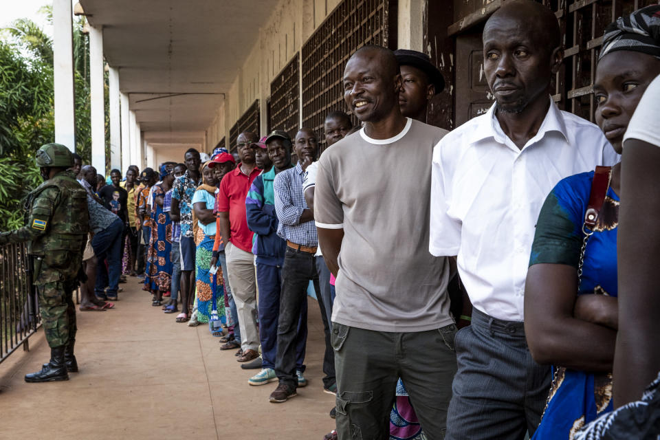 People queue to cast their votes for presidential and legislative elections, at the Lycee Boganda polling station in the capital Bangui, Central African Republic, Sunday, Dec. 27, 2020. President Faustin-Archange Touadera and his party said the vote will go ahead after government forces clashed with rebels in recent days and some opposition candidates pulled out of the race amid growing insecurity. (AP Photo)