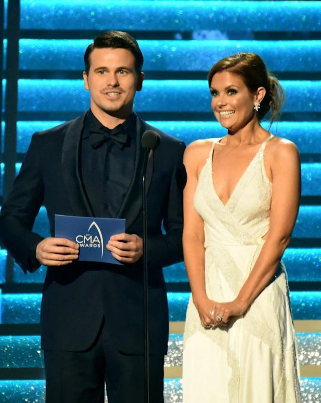 <p>Jason Ritter and JoAnna Garcia Swisher speak onstage at the 51st annual CMA Awards at the Bridgestone Arena on November 8, 2017 in Nashville, Tennessee. (Photo by Rick Diamond/Getty Images) </p>