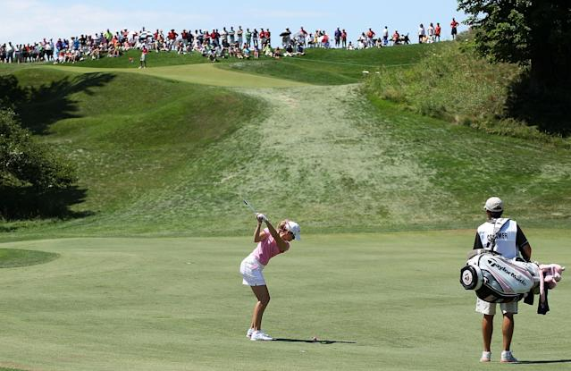 KOHLER, WI - JULY 08: Paula Creamer hits her second shot on the first hole as her caddie Colin Cann looks on during the final round of the 2012 U.S. Women's Open on July 8, 2012 at Blackwolf Run in Kohler, Wisconsin. (Photo by Scott Halleran/Getty Images)