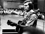 """FILE - In this undated photo, Country singer George Jones is shown performing with his guitar. Jones, the peerless, hard-living country singer who recorded dozens of hits about good times and regrets and peaked with the heartbreaking classic """"He Stopped Loving Her Today,"""" has died. He was 81. Jones died Friday, April 26, 2013 at Vanderbilt University Medical Center in Nashville after being hospitalized with fever and irregular blood pressure, according to his publicist Kirt Webster. (AP Photo, File)"""