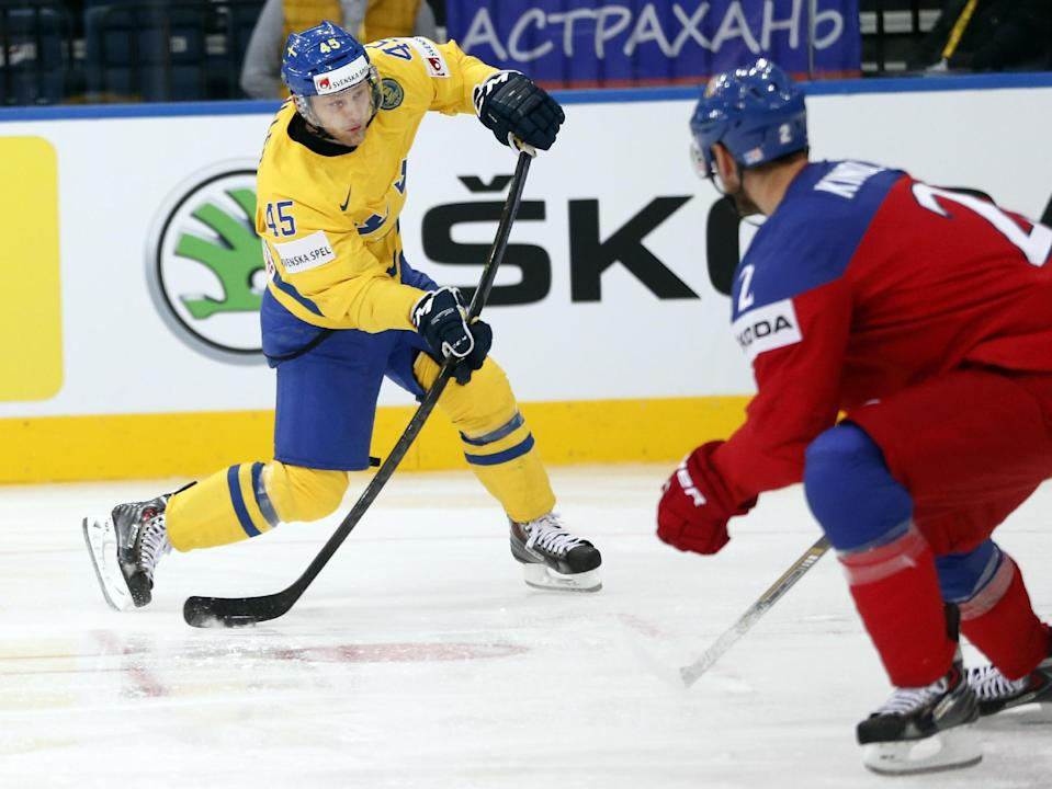 Sweden's forward Oscar Moller attempts to shoot during the bronze medal match between Sweden and Czech Republic at the Ice Hockey World Championship in Minsk, Belarus, Sunday, May 25, 2014. (AP Photo/Darko Bandic)