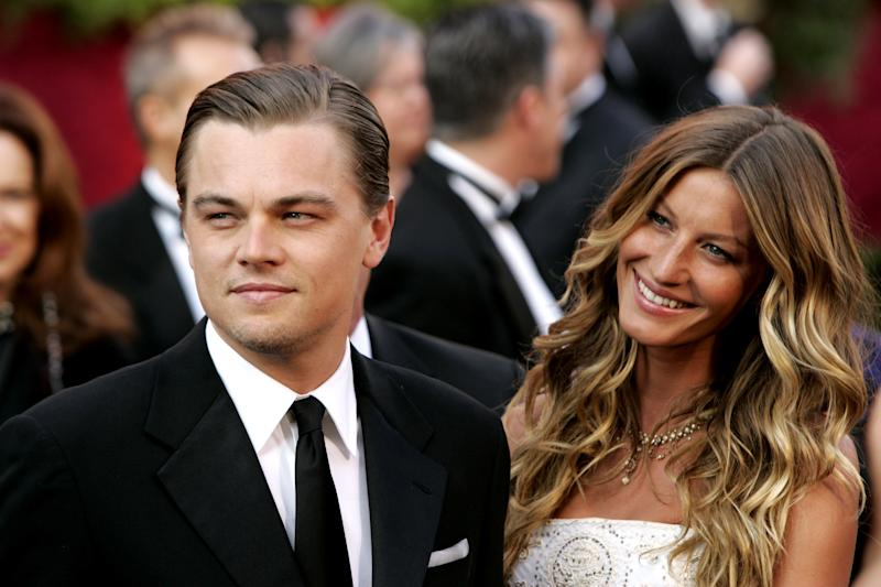 """Leonardo DiCaprio, nominee Best Actor in a Leading Role for """"The Aviator"""" and Gisele Bundchen (Photo by Chris Polk/FilmMagic)"""
