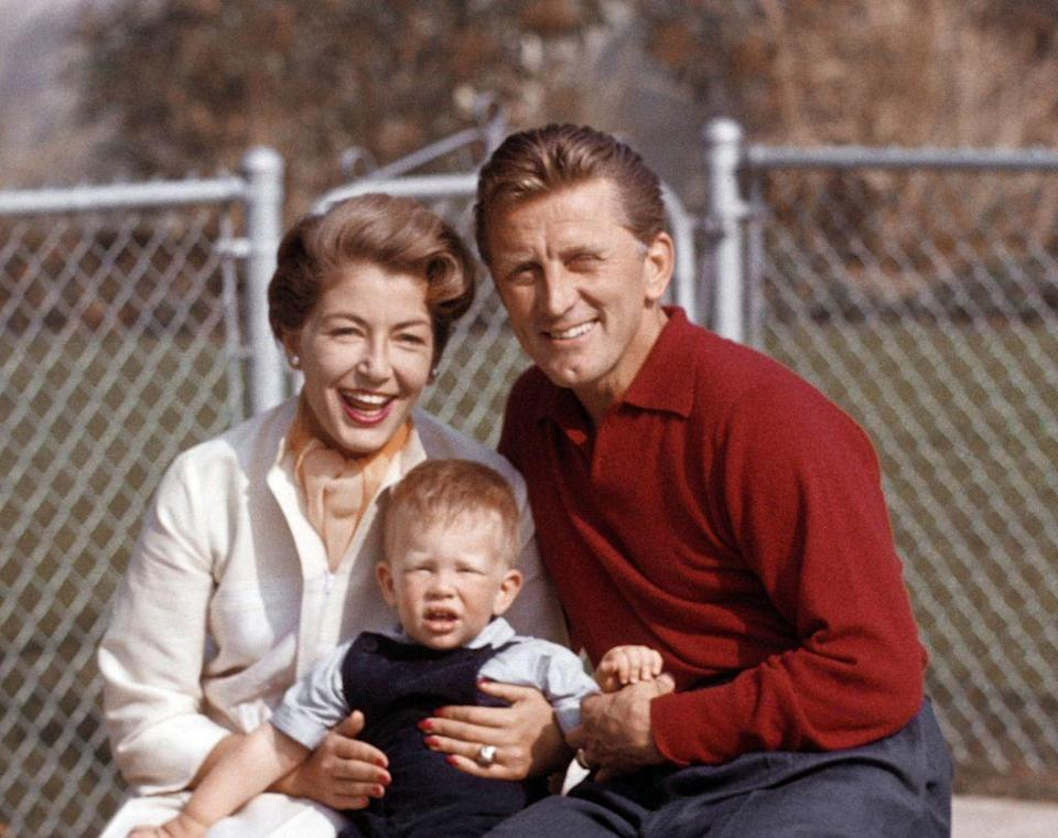 <p>Kirk poses with his second wife, Anne Buydens, and their eldest son, Peter. The couple welcomed their second child, Eric, in 1958. </p>