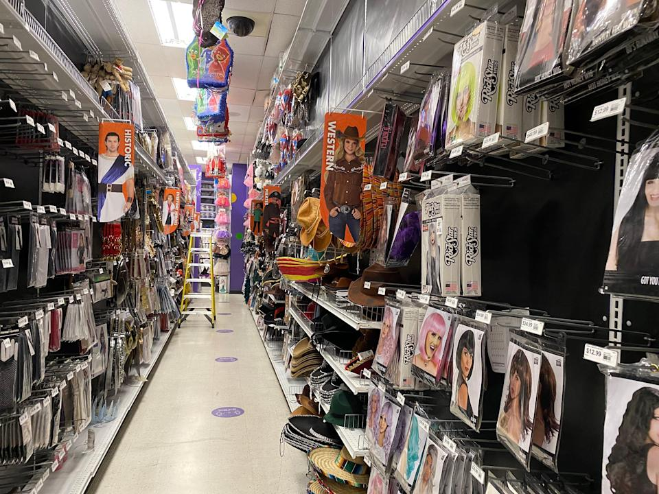 Themed aisle filled with western costumes at party city