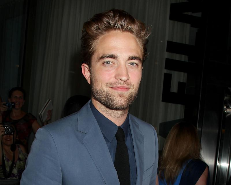 """This Monday, Aug. 13, 2012 photo released by Starpix shows actor Robert Pattinson attending the premiere of """"Cosmopolis"""" at the Museum of Modern Art in New York.  (AP Photo/Starpix, Dave Allocca)"""