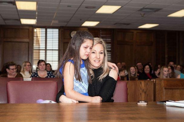 PHOTO: Selah Scott, 8, is seen with her mother, Suzanne Scott in Lubbock, Texas, on March 5 as she was adopted among family and friends (Hollie Epperson)