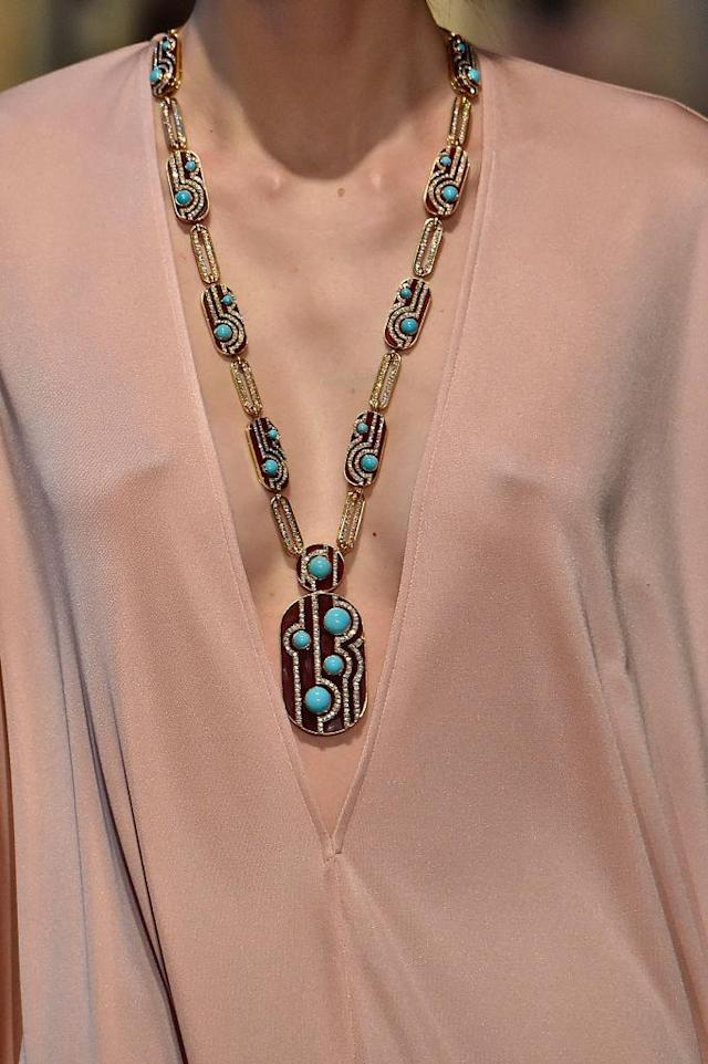 <p>Gold and turquoise pendant necklace at the Emilio Pucci FW18 show. (Photo: Getty Images) </p>