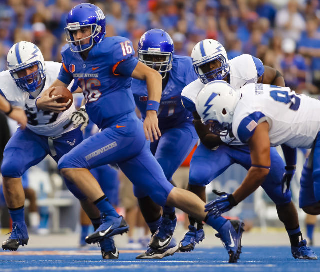 Boise State quarterback Joe Southwick (16) tries to get away from a trio of Air Force defenders during the first half of an NCAA college football game in Boise, Idaho, Friday, Sept. 13, 2013. (AP Photo/Otto Kitsinger)