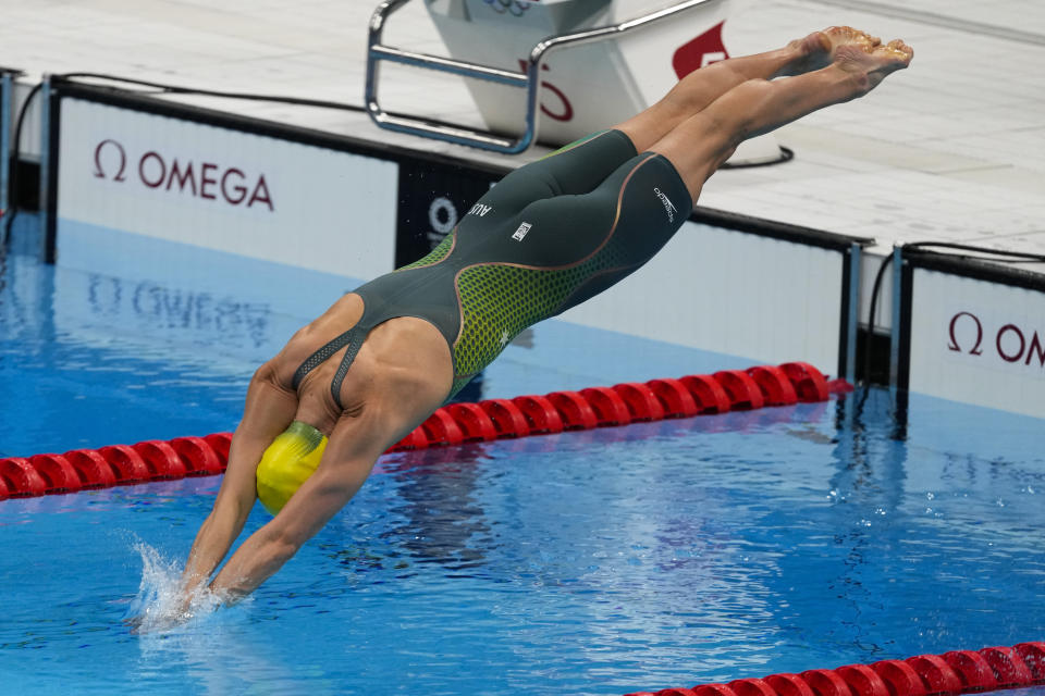 Emma Mckeon, of Australia, dives off the starting block in the women's 50-meter freestyle final at the 2020 Summer Olympics, Sunday, Aug. 1, 2021, in Tokyo, Japan. (AP Photo/Jae C. Hong)