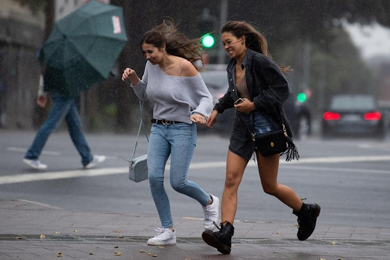 Pedestrian are seen during wet weather in Manly, Sydney.