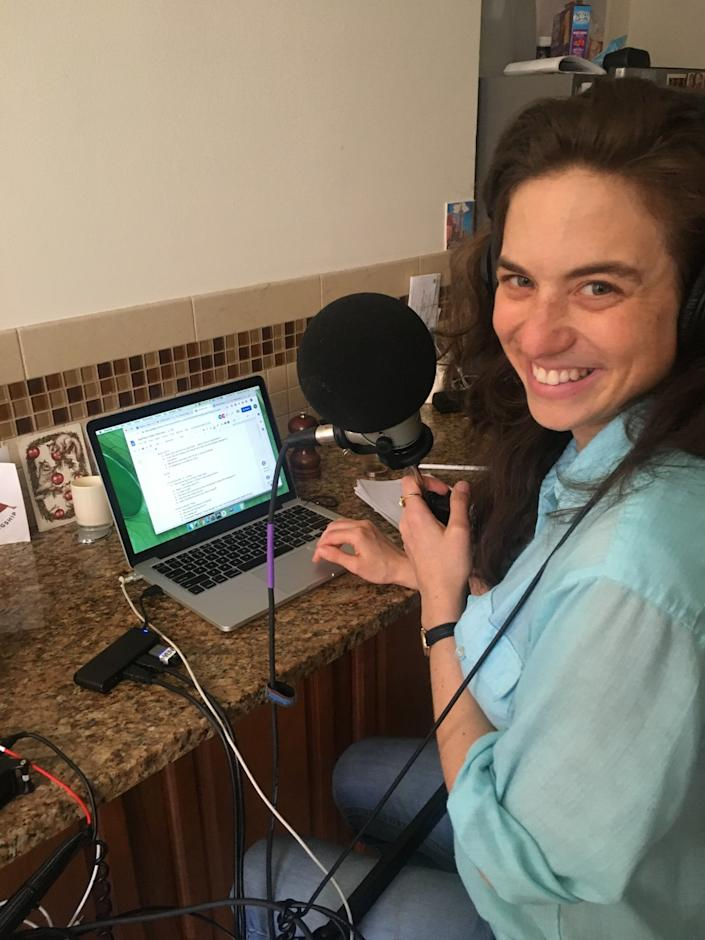 """Wendy Zukerman, host of """"Science Vs,"""" works from her kitchen, as more podcasters are doing home recordings instead of going to a studio during the coronavirus crisis. <span class=""""copyright"""">(Wendy Zukerman)</span>"""