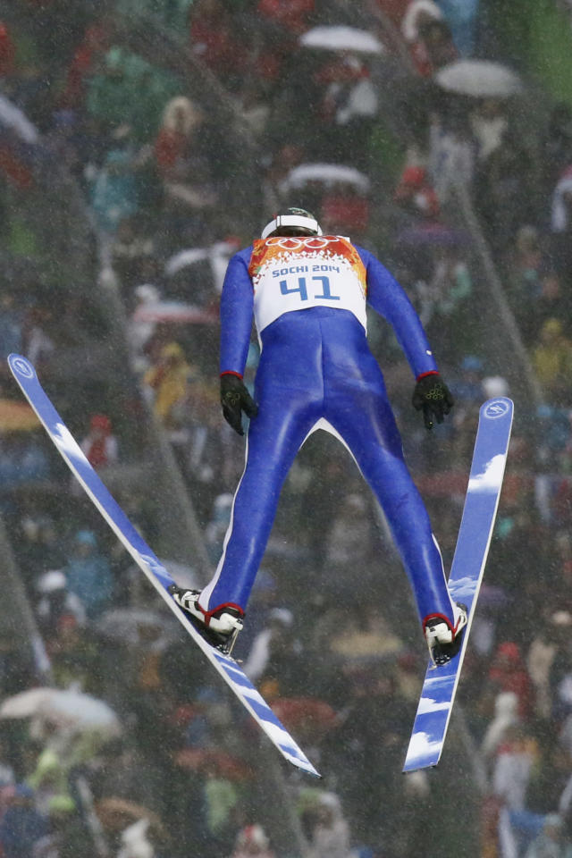 Norway's Magnus Hovdal Moan makes his jump during the Nordic combined individual Gundersen large hill competition at the 2014 Winter Olympics, Tuesday, Feb. 18, 2014, in Krasnaya Polyana, Russia. (AP Photo/Dmitry Lovetsky)