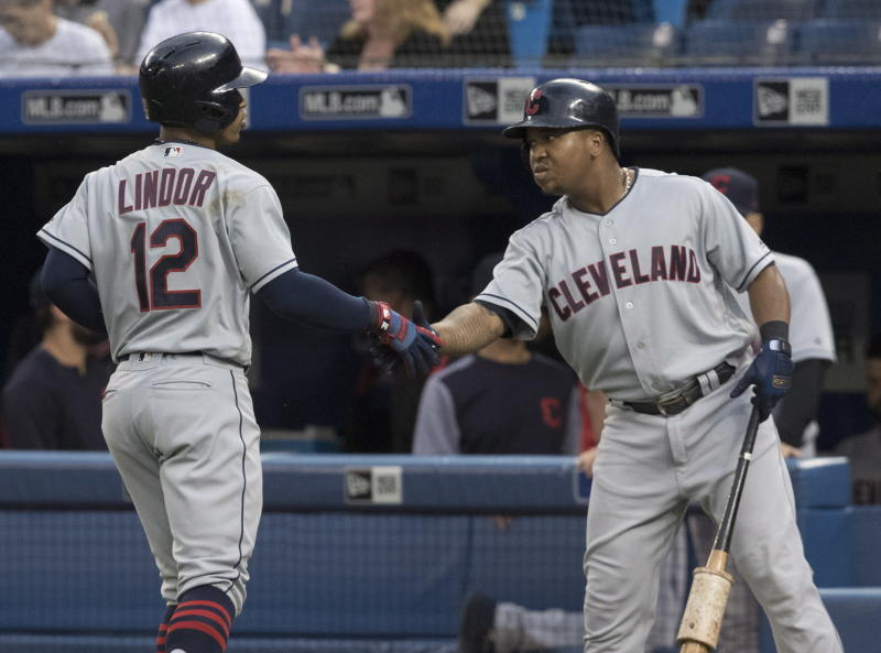 Francisco Lindor of the Indians celebrates with Jose Ramirez after hitting of two home runs on Thursday. (AP)