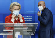 European Council President Charles Michel, right, and European Commission President Ursula von der Leyen put on their protective face mask at the end of a media conference after an EU summit in video conference format at the European Council building in Brussels, Thursday, Oct. 29, 2020. EU leaders held a video conference to address the need to strengthen the collective effort to fight the COVID-19 pandemic. (Olivier Hoslet, Pool via AP)