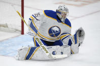 Buffalo Sabres goaltender Linus Ullmark (35) stops the puck during the first period of an NHL hockey game against the Washington Capitals, Friday, Jan. 22, 2021, in Washington. (AP Photo/Nick Wass)