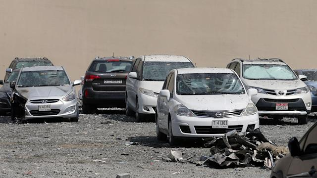 """<p>A picture taken on August 4, 2017 shows parked cars damaged by the fire that hit """"The Torch"""", one of the tallest towers in Dubai, early in the morning. (Photo: Karim Sahib/AFP/Getty Images) </p>"""