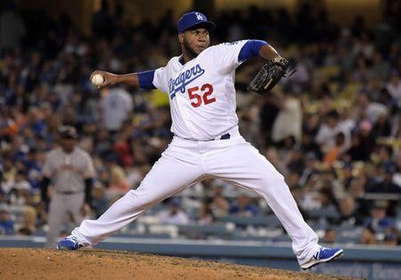 Apr 1, 2019; Los Angeles, CA, USA; Los Angeles Dodgers relief pitcher Pedro Baez (52) delivers a pitch against the San Francisco Giants at Dodger Stadium. Mandatory Credit: Kirby Lee-USA TODAY Sports