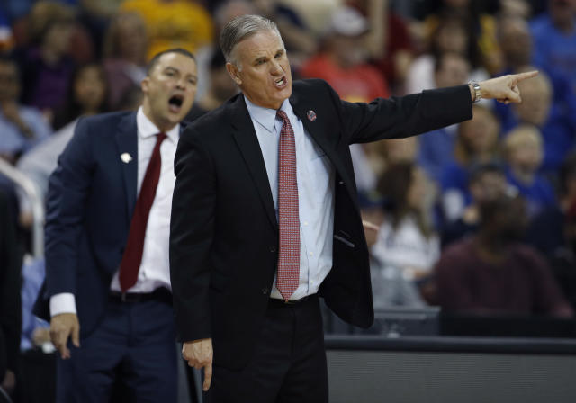 San Diego State head coach Brian Dutcher talks to an official during the second half of an NCAA men's college basketball tournament first-round game against Houston Thursday, March 15, 2018, in Wichita, Kan. Houston won 67-65. (AP Photo/Charlie Riedel)