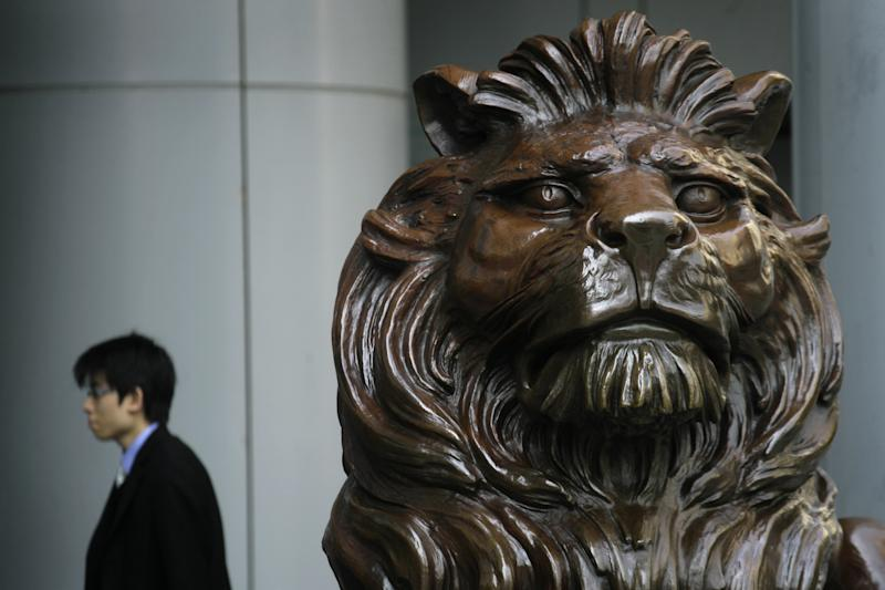 A bronze lion statue is seen outside the HSBC headquarters in Hong Kong Monday, March 3, 2008. HSBC Holdings PLC said Monday that net profit rose 21 percent, as sharp growth in its Asian operations helped offset hefty impairments on subprime and other loans in its U.S. consumer finance business. (AP Photo/Vincent Yu)