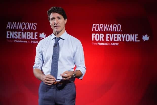 Liberal Leader Justin Trudeau reveals his party's election platform in Toronto on Wednesday. The Liberals say they want to ban blind bidding on home sales, claiming it drives up prices.  (Nathan Denette/The Canadian Press - image credit)