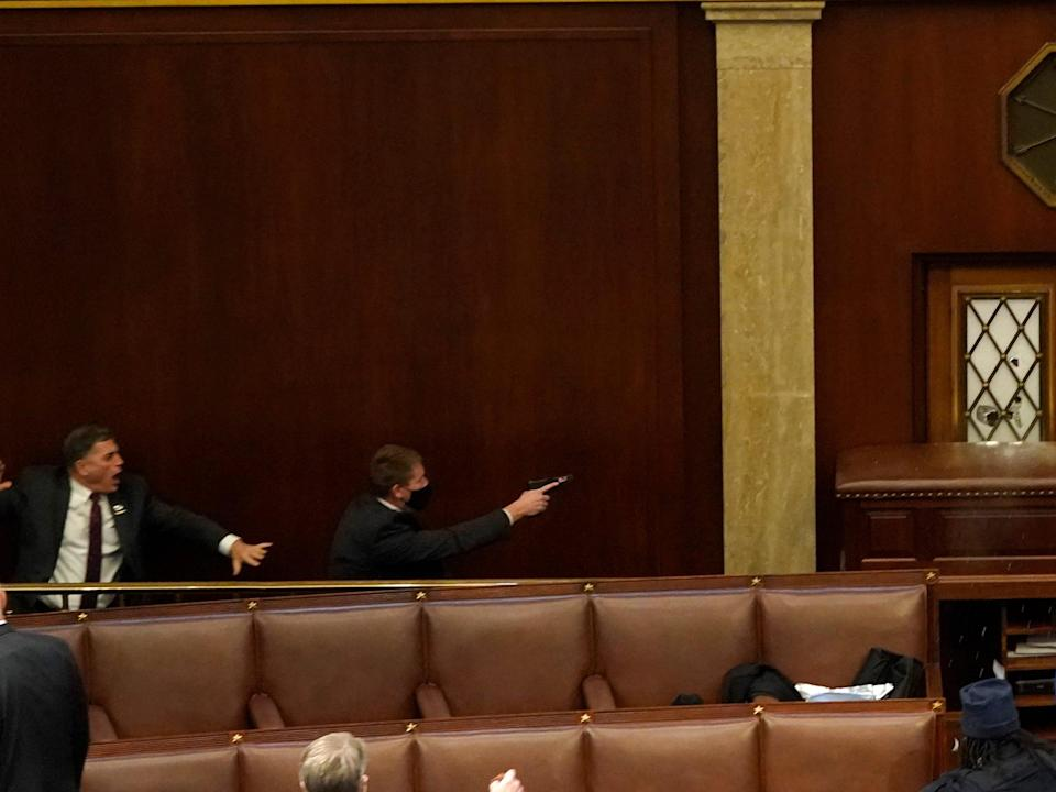 <p>Andrew Clyde (left) in the House chamber on 6 January</p> (Getty)