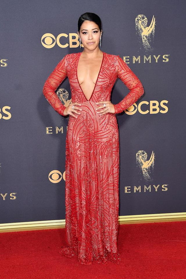 "<p>Rodriguez gave new meaning to ""red hot"" in this plunging gown from Naeem Khan. (Photo: Getty Images) </p>"