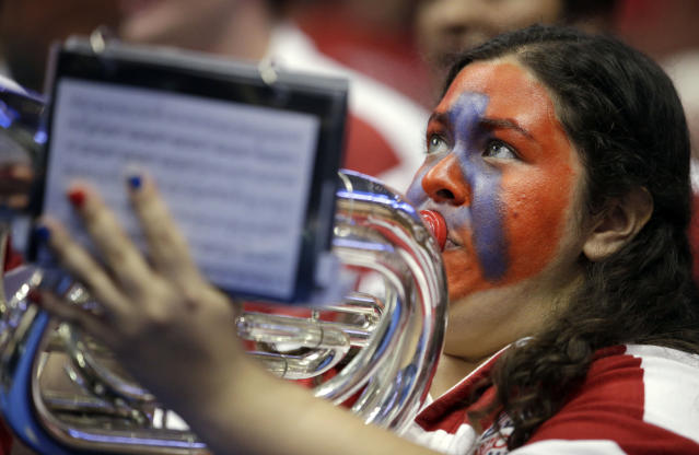 A member of the Arizona band plays before a regional final NCAA college basketball tournament game against Wisconsin, Saturday, March 29, 2014, in Anaheim, Calif. (AP Photo/Jae C. Hong)